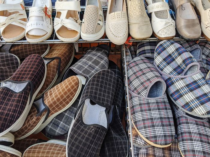 High angle view of various for shoes for sale in market