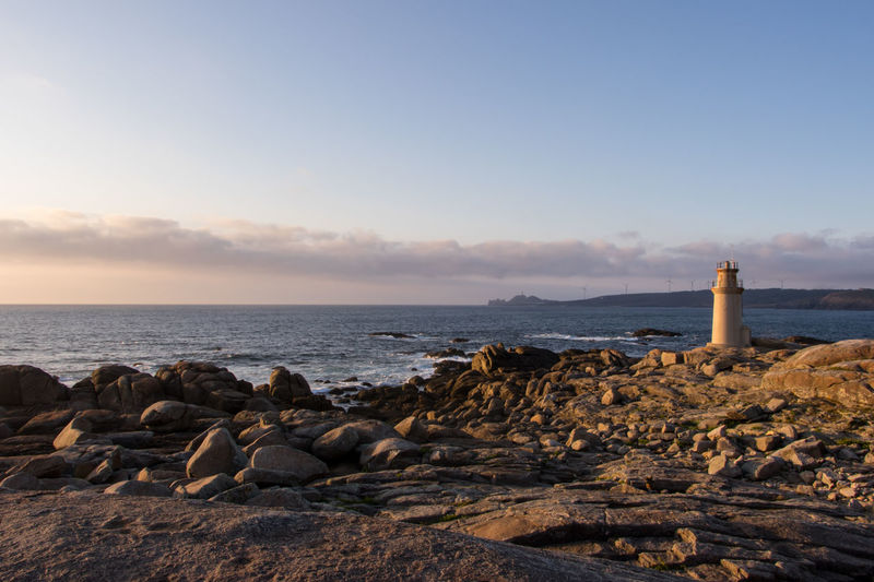 Faro de Muxía, Costa da Morte Atlantic Ocean Galicia Lighthouse SPAIN Architecture Beach Beauty In Nature Day España Horizon Over Water Landscape Lighthouse Nature No People Outdoors Rock - Object Scenics Sea Sky Sunset Tranquil Scene Tranquility Water
