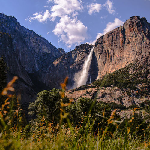 Low angle view of waterfall on mountain at yosemite national park