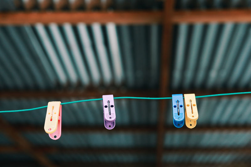 Hanging Clothesline Clothespin Focus On Foreground No People In A Row Clothing Side By Side Close-up String Plastic Indoors  Number Group Of Objects Text Blue Repetition Still Life Rope Day