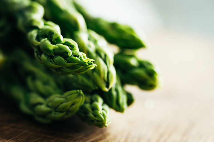 Green Asparagus Asparagus Close-up Copy Space Focus On Foreground Food Food And Drink Freshness Green Color Healthy Eating Indoors  No People Organic Raw Food Selective Focus Still Life Studio Shot Table Vegetable Wellbeing Wood - Material Wood Grain