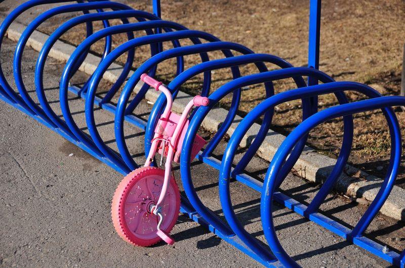 High angle view of bicycle wheel on rack