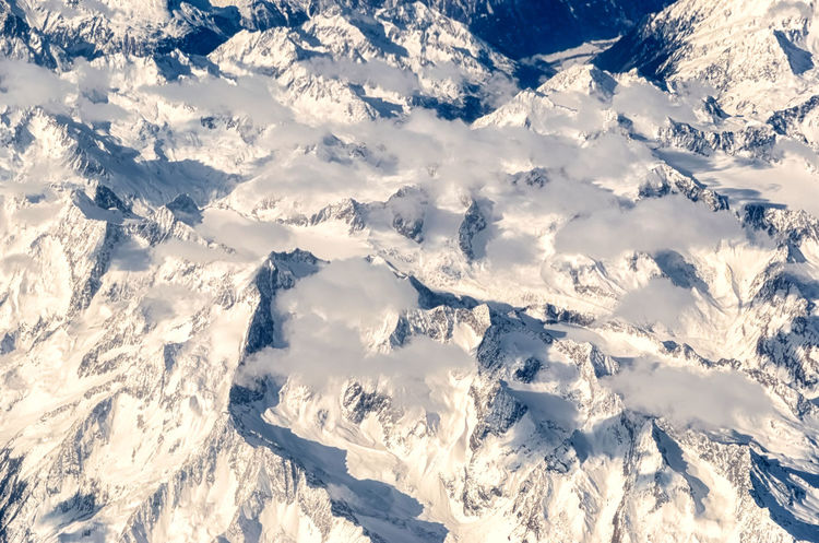Flying over the Alps. Fly Fly Over Hanging Out Looking Down Nature Travel Winter Above Aerial View Alps Blue Clouds Cold Temperature Eoropean Europe In Flight Landscape Mountain Range Mountains Peaks Scenics Sky Snow Top Perspective Top View