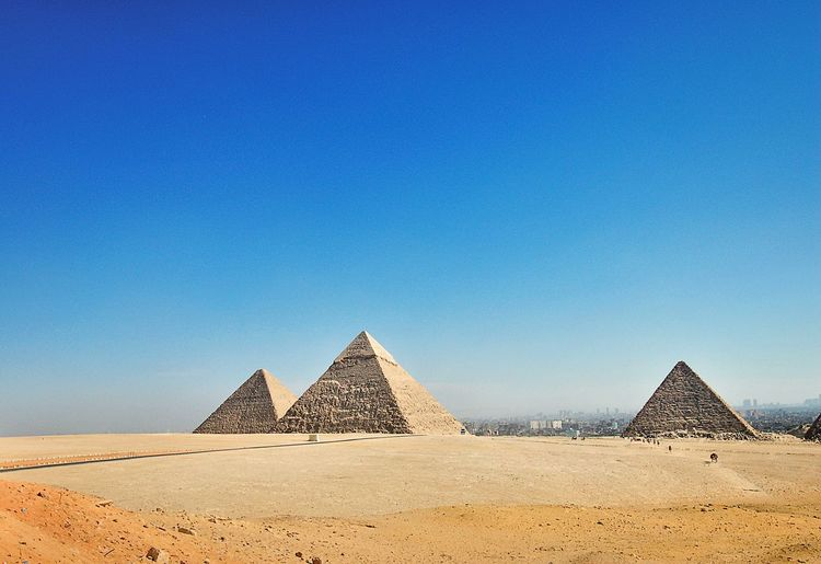 Pyramids at Giza, Cairo, Egypt. Ancient Civilization Blue Deserts Around The World Eye4photography  Eyemphotography Landscape Pyramid Taking Photos Tranquil Scene Market Reviewers' Top Picks