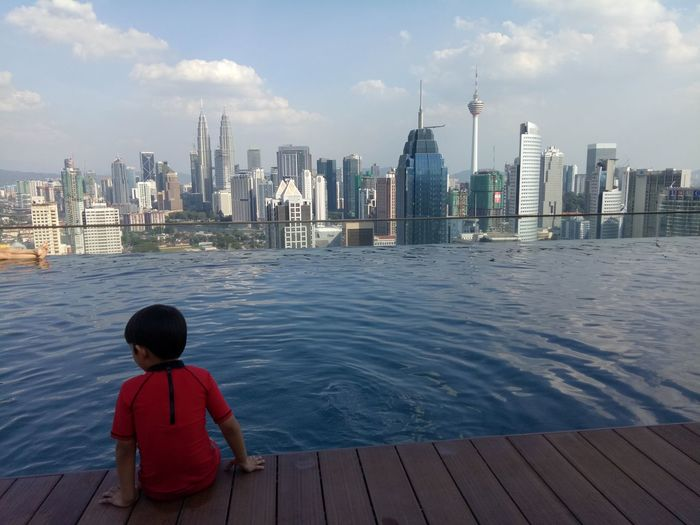 I like the water An Eye For Travel Skyscraper Urban Skyline Cityscape City Architecture Travel Destinations Building Exterior Vacations Modern Water Day Sky One Person