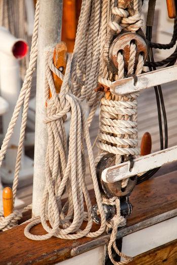 Close-up of ropes tied at ship