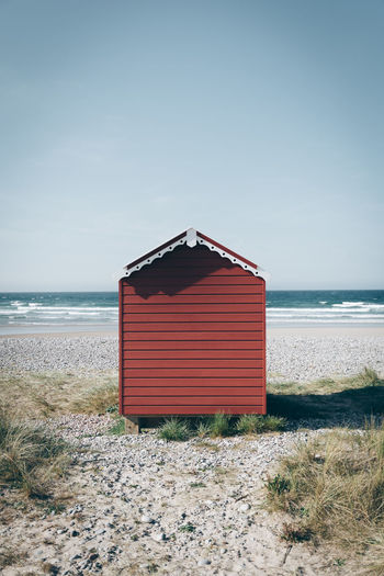 Beach hut against sea