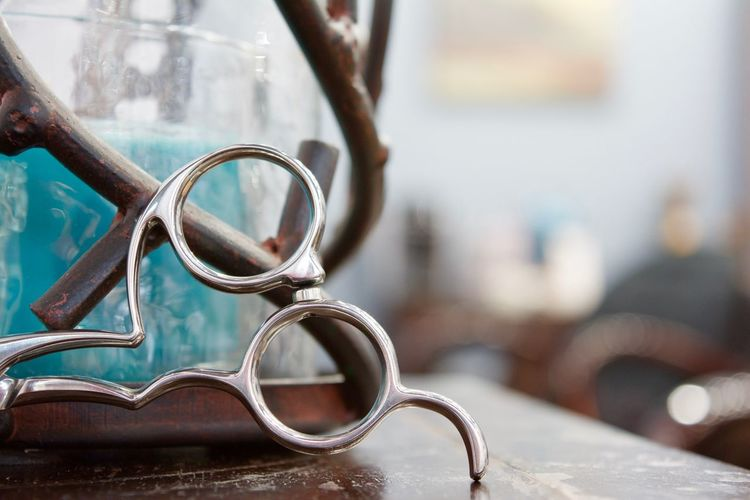 Cropped image of scissors on table at shy hair studio
