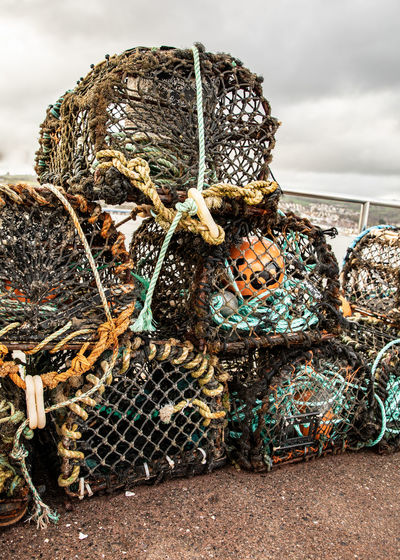 Fishermen lobster pots dstacked Fishing Tackle Fishing Equipment Fishing Net Lobster Traps Shaldon Shaldon Devon Day Fishing Fishing Industry Fishing Net Fishing Trap Fishing Traps Lobster Pots Lobsters No People Outdoors Rope Seaside Seaside_collection Stack Traps