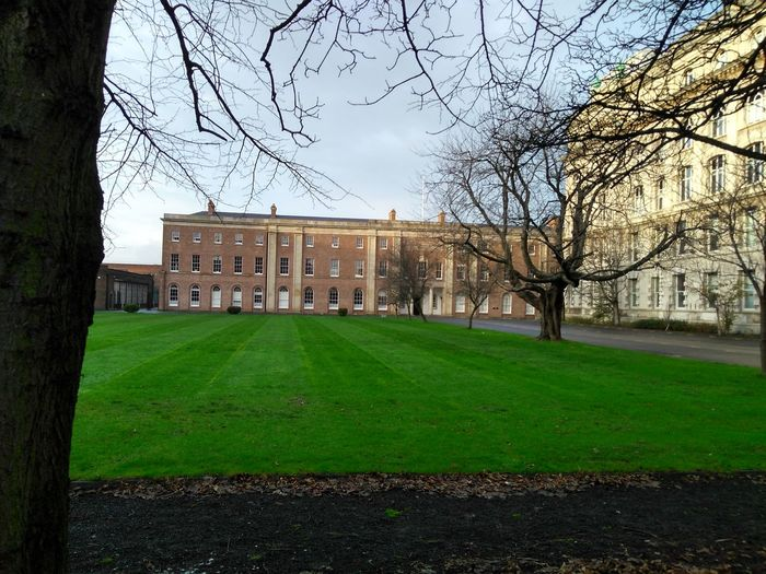 the royal Belfast academical institution School University Institution Royal Traditional Academics Study Tree Bare Tree Soccer Field City Soccer Sky Grass Architecture Green Color Built Structure Ice Rink Goal Scoring A Goal Goal Post Ice Hockey