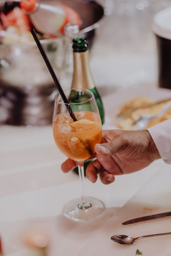 Waiter preparing drink Champagne Drinks Freshness Ice Cube Party Time Wine Glass Alcohol Bar Catering Catering Service Club Cold Drink Drink Time Drinking Glass Food Glass Hand Party Restaurant Serving Straw Table Waiter