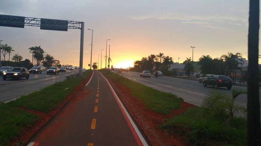 Por do Sol. City Sunset Road Car Road Sign Traffic Sky Bicycle Lane