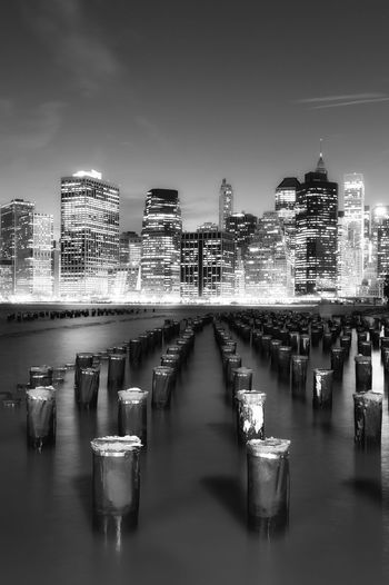 New York in Black and White Built Structure Architecture Building Exterior City Water Sky Illuminated Building Nature Waterfront Night No People Urban Skyline Office Building Exterior Outdoors River Modern Skyscraper Tall - High Cityscape Post Wooden Post New York NYC Big Apple