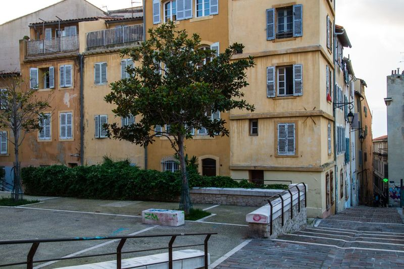 marseille,le panier,bouche du rhone,france Apartment Building Exterior Architecture Built Structure Building Plant City Tree Window Nature Residential District Table Day No People Outdoors Seat Chair Street Growth Town Potted Plant