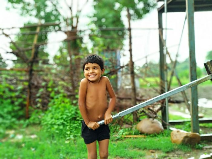 Tree Child City Childhood Smiling Portrait Males  Boys Happiness Shirtless Moments Of Happiness 2018 In One Photograph 17.62°