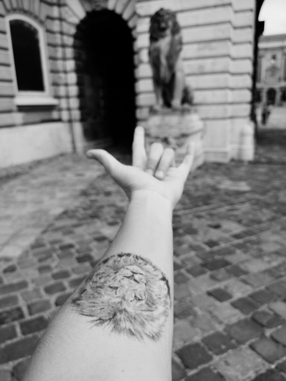 human body part, real people, architecture, lifestyles, hand, human hand, personal perspective, body part, focus on foreground, building exterior, people, tattoo, built structure, day, women, human finger, finger, adult, city, human limb, human arm