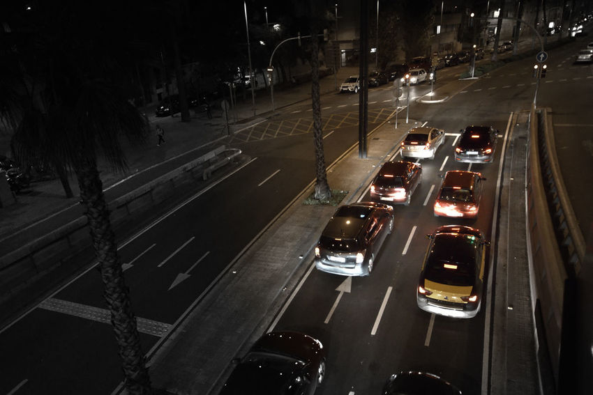 Cars in the Barcelona's avenue Transportation Night Car Motor Vehicle Illuminated Sign Land Vehicle Mode Of Transportation City Street High Angle View Traffic No People Street Light Barcelona Taxi on the move