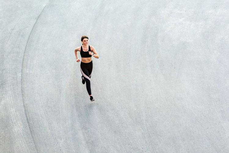 High angle view of teenage boy running
