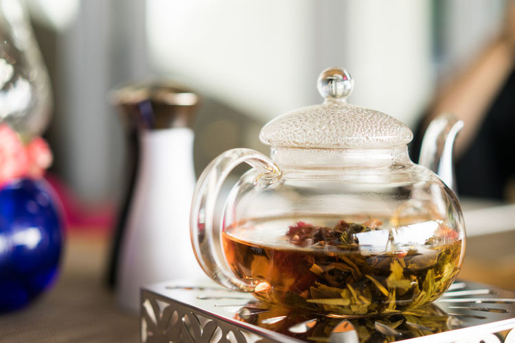 Close-Up Of Herbal Tea In Kettle On Table