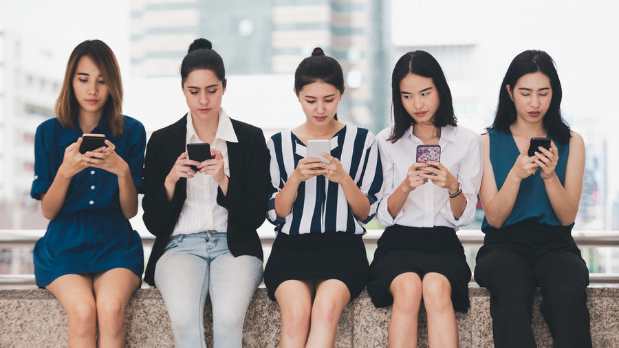 Group of people using smart phone