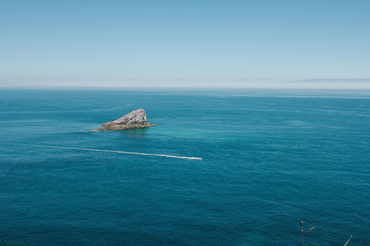 High angle view of calm blue sea against clear sky