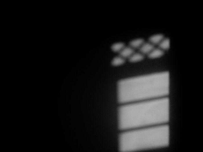 Close-up of electric lamp in darkroom