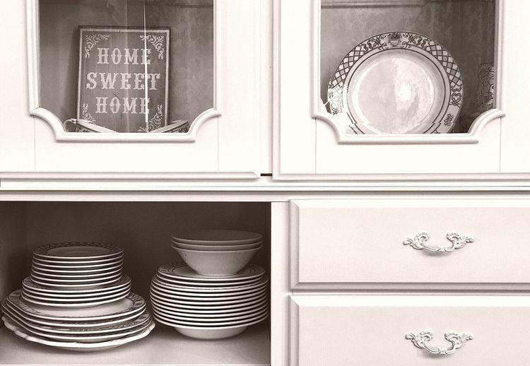 Ceramics Arranged In Cabinet At Kitchen