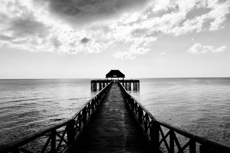 Sea Water Horizon Over Water Pier Tranquil Scene Sky Jetty Built Structure Scenics The Way Forward Tranquility Beauty In Nature Nature Outdoors Cloud - Sky No People Day Architecture Wood Paneling