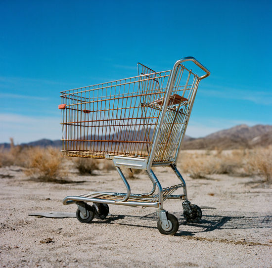 Carting Out 6x6 Desert Blue Day Film Photography Medium Format Outdoors Shopping Cart