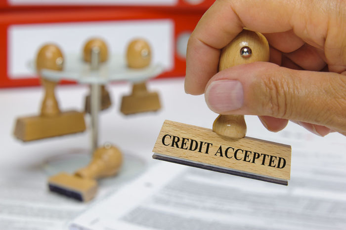credit accepted printed on rubber stamp in hand Accepted Business Industry Loan  Acceptance Account Accounting AllOwed Allow Approval Approved Bank Banking Business Finance And Industry Close-up Confirmed Consumer Contract Credit Debt Finance Holding Human Hand Stamp Text