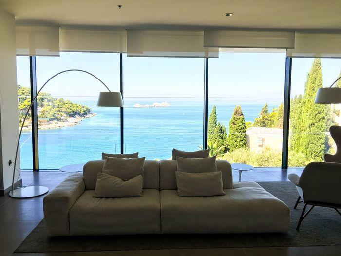 Scenic view of sea seen through home window