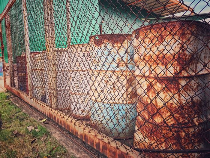 Old gasoline tanks Rusty Old Protection Sky Day Outdoors Cage Metal Close-up No People Chainlink Fence Animal Themes Gasoline Tank