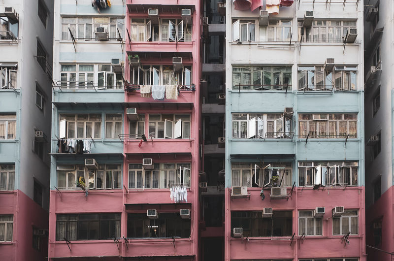 Building Exterior Built Structure Architecture Full Frame Backgrounds Residential District Window Building No People Day City Pink Color Outdoors Balcony Large Group Of Objects Glass - Material Side By Side In A Row Apartment