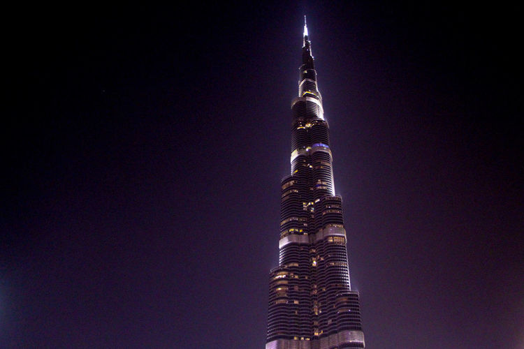 Architecture Tall - High Building Exterior Built Structure Sky Low Angle View Tower Night Office Building Exterior Skyscraper Building No People Clear Sky Illuminated Travel Destinations Nature City Outdoors Travel Spire  Financial District  Burj Khalifa Dubai