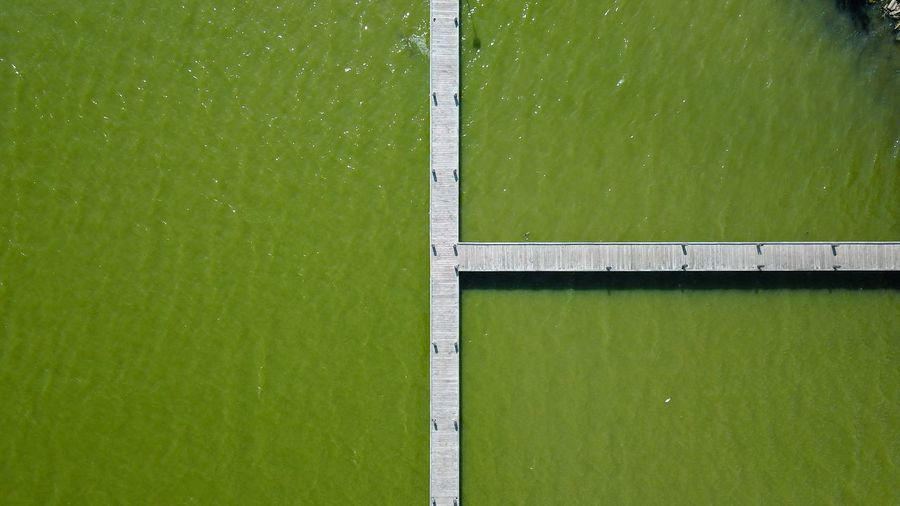 Green Color High Angle View Day Grass No People Sport Outdoors Full Frame Backgrounds Water Playing Field Nature Soccer Field Tennis Court Simple Symmetry Lake Dronephotography Drone