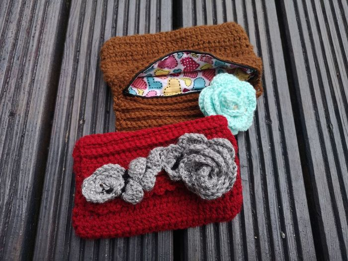 High angle view of woolen pouch on wooden table