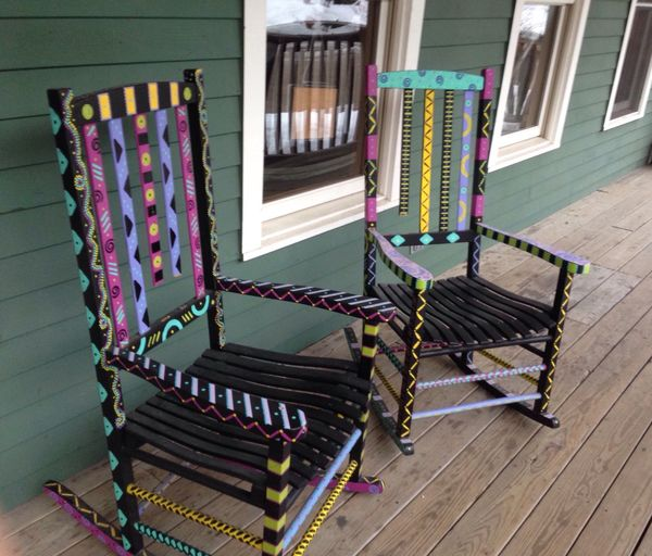 Colorful rocking chairs on porch