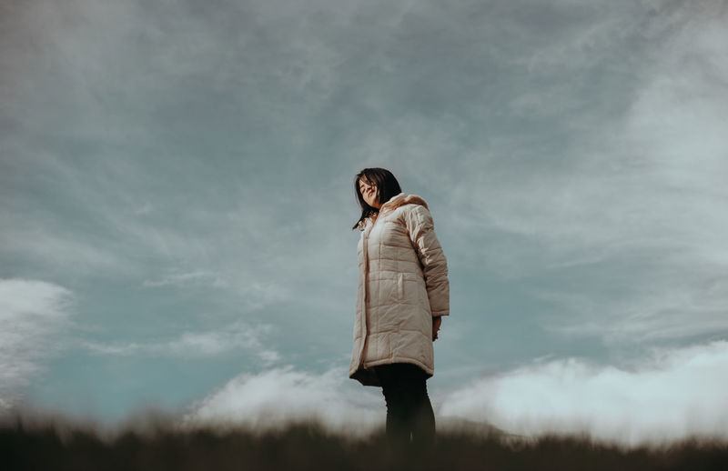 Winter Coat Cloud - Sky One Person Standing Young Adult Real People Sky Three Quarter Length Casual Clothing Lifestyles Nature Leisure Activity Young Women Day Adult Women Full Length Looking Away Outdoors Teenager First Eyeem Photo