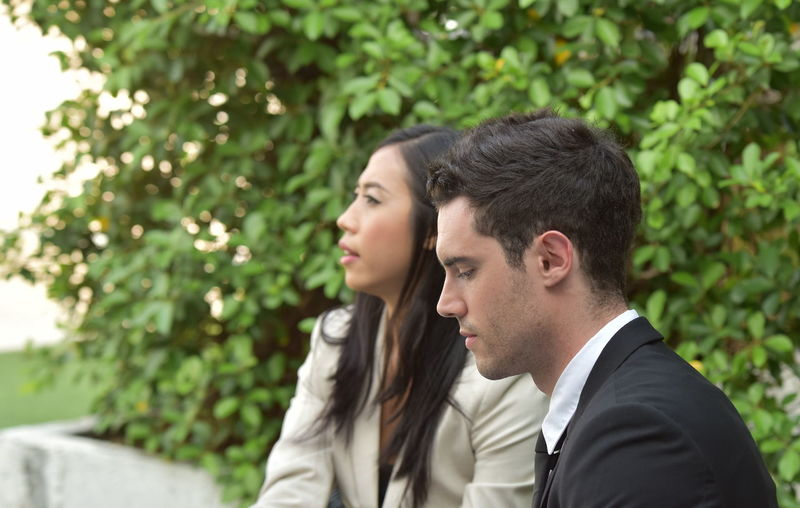 Two People Headshot Portrait Plant Togetherness Young Adult Tree Young Men Side View Focus On Foreground Looking Day Men Real People People Love Young Women Couple - Relationship Adult Contemplation Outdoors Positive Emotion