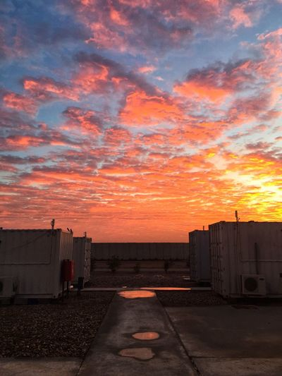 Sunrise in a base camp Cloud - Sky Sunset Architecture Sky Orange Color Built Structure No People Nature Road Transportation City Building Exterior Dramatic Sky Street Direction Outdoors The Way Forward Water Building Beauty In Nature