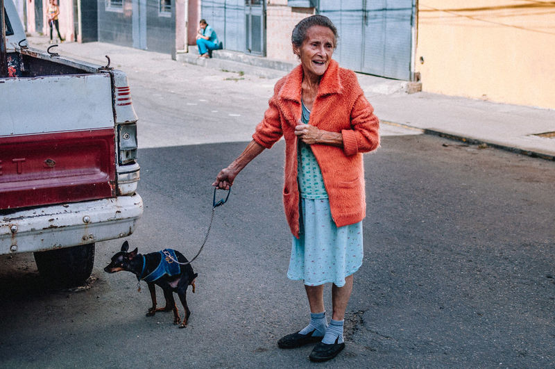 Pets Care Pets Domestic Domestic Animals Real People Mammal One Person One Animal Senior Adult Canine Dog Vertebrate Adult Front View Full Length Senior Women Day Smiling Mature Adult Pet Owner Outdoors Street Photography EyeEm Best Shots EyeEm Selects The Art Of Street Photography The Street Photographer - 2019 EyeEm Awards