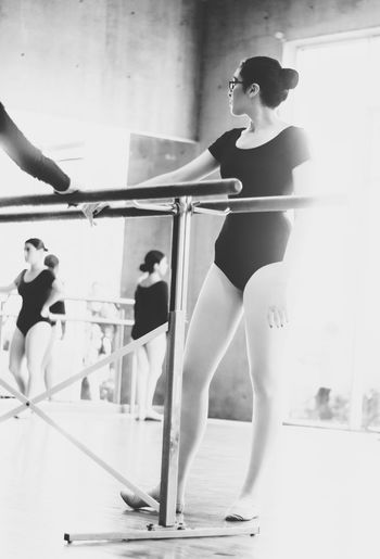 Balance Ballet Ballet Dancer Ballet Studio Concentration Exercising Expertise Focus On Foreground Front View Full Length Healthy Lifestyle Indoors  Leisure Activity Lifestyles One Person Performance Practicing Real People Skill  Sports Clothing Standing Strength Teenage Girls Young Adult Young Women