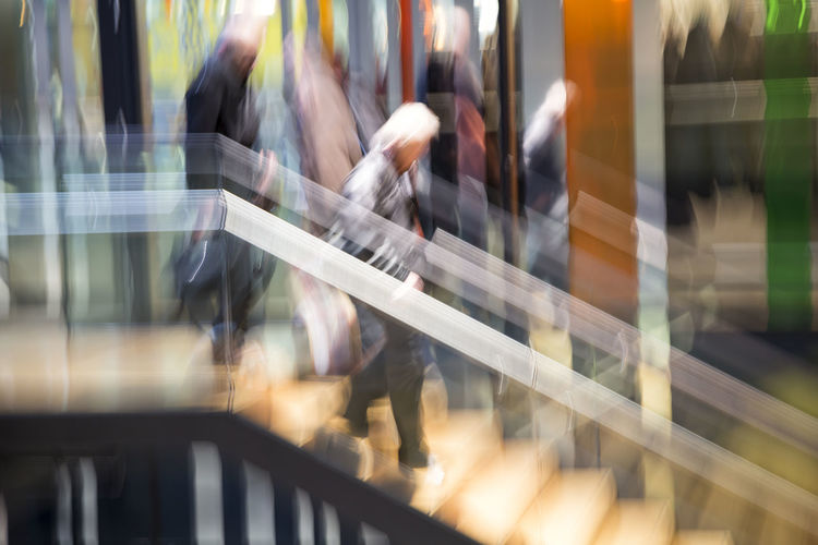 People in modern interior, motion blur Adult Blur Blurred Motion Businesspeople Center Commuter Concept Indoors  Mall Man Men Motion Motion Blur Office Outdoors People Person Rushing Shop Silhouette Together Unrecognizable People Unrecognizable Person Walking Woman