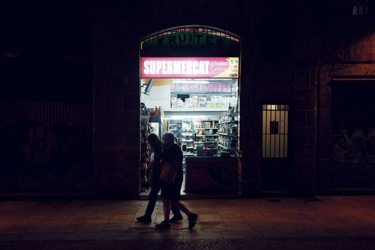 Full length of man in illuminated city at night