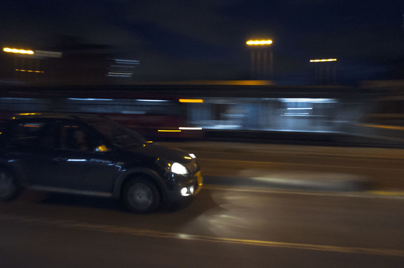 Blurred motion of car on street at night