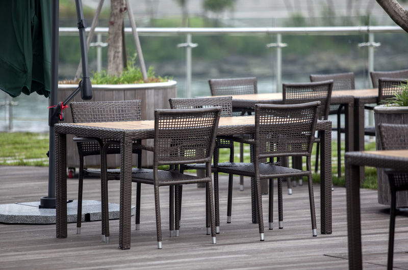 Whicker chairs and tables at outdoor cafe