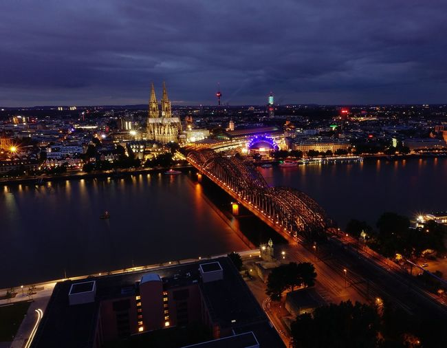 Außenaufnahme Nachtaufnahme Cologne , Köln,  Architecture Bridge Bridge - Man Made Structure Building Building Exterior Built Structure City Cityscape Cloud - Sky Connection High Angle View Illuminated Long Exposure Nature Night No People Office Building Exterior Outdoor Photography Outdoors River Sky Skyscraper Transportation Water