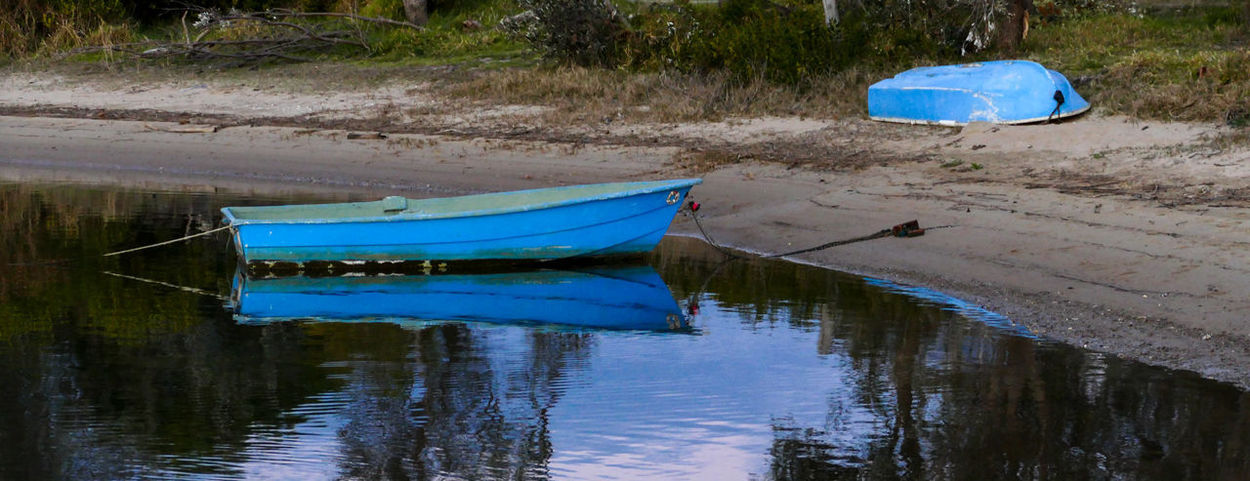 Mogareeka Beauty In Nature Blue Boats Day Lake Last Light Moored Nature Nautical Vessel No People Outdoors Reflection Tranquility Transportation Water Waterfront