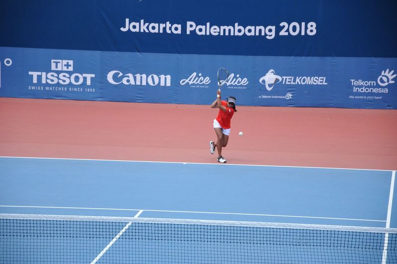 tennis player of indonesia Tennis Women Soft Tennis Asian Games 2018 Athlete Sportsman Sports Clothing Competition Sports Track Full Length Sport City Track And Field Event Stadium Racket Tennis Racket Racket Sport Net - Sports Equipment Serving - Sport Tennis Net Table Tennis Volleyball - Sport Taking A Shot - Sport Sun Visor Track And Field Beach Volleyball Hitting Tennis Ball Starting Line Running Track