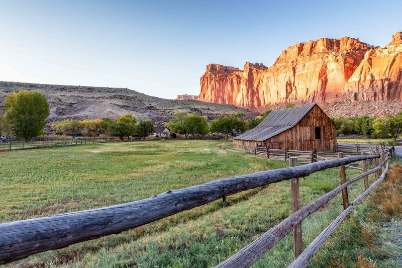 America Can Capitol Reef National Aprk Day Fence Fruita Camp Ground Grass Green Color Mountain Nature No People Outdoors Sky Sun Tree USA